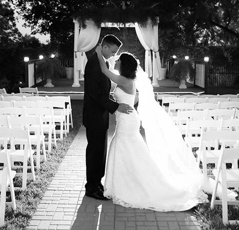 Couple at Gardenside ceremony area, black and white